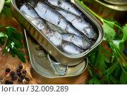 Купить «Open can of sardines on table», фото № 32009289, снято 20 сентября 2019 г. (c) Яков Филимонов / Фотобанк Лори