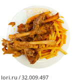 Купить «Mutton meat in sauce stewed in oven», фото № 32009497, снято 29 мая 2020 г. (c) Яков Филимонов / Фотобанк Лори