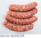 Купить «Raw farm sausages», фото № 32010725, снято 19 октября 2019 г. (c) Яков Филимонов / Фотобанк Лори