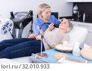 Купить «Cosmetician performing hardware face treatment», фото № 32010933, снято 16 марта 2018 г. (c) Яков Филимонов / Фотобанк Лори