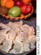 Traditonal Polish food called pierogi in a glass bowl ready to be served. Стоковое фото, фотограф Zoonar.com/Pawel Opaska / easy Fotostock / Фотобанк Лори