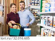 Купить «Man and woman with paint and all instruments», фото № 32016605, снято 16 февраля 2018 г. (c) Яков Филимонов / Фотобанк Лори