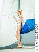Купить «Young beautiful slim sexy girl in bikini and pareo is resting on cruise on a private sailing yacht», фото № 32017069, снято 25 июля 2017 г. (c) katalinks / Фотобанк Лори