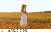 Купить «woman in straw hat on cereal field in summer», видеоролик № 32017345, снято 4 августа 2019 г. (c) Syda Productions / Фотобанк Лори
