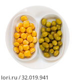 Купить «Top view of green olives and pickled lupini beans», фото № 32019941, снято 19 августа 2019 г. (c) Яков Филимонов / Фотобанк Лори