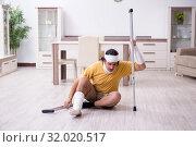 Купить «Young man after accident recovering at home», фото № 32020517, снято 3 мая 2019 г. (c) Elnur / Фотобанк Лори