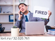 Купить «Young male employee being fired from his work», фото № 32020761, снято 17 апреля 2019 г. (c) Elnur / Фотобанк Лори