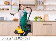 Купить «Young female contractor doing housework», фото № 32024693, снято 22 февраля 2019 г. (c) Elnur / Фотобанк Лори