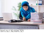 Купить «Female employee in hijab working in the office», фото № 32024721, снято 20 февраля 2019 г. (c) Elnur / Фотобанк Лори