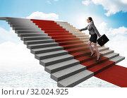 Купить «Young businesswoman climbing stairs and red carpet», фото № 32024925, снято 25 августа 2019 г. (c) Elnur / Фотобанк Лори