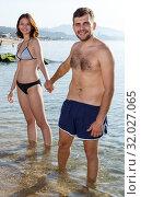 Young couple dressed in beachwear. Стоковое фото, фотограф Яков Филимонов / Фотобанк Лори