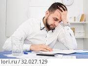 Купить «Man struggling to pay bills», фото № 32027129, снято 5 марта 2017 г. (c) Яков Филимонов / Фотобанк Лори