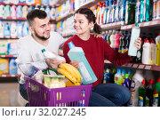 Купить «two cheerful adult people in good spirits selecting detergents in the store», фото № 32027245, снято 14 марта 2017 г. (c) Яков Филимонов / Фотобанк Лори