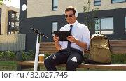 Купить «businessman with tablet pc, headphones and scooter», видеоролик № 32027745, снято 5 августа 2019 г. (c) Syda Productions / Фотобанк Лори