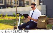 Купить «businessman with tablet pc, headphones and scooter», видеоролик № 32027769, снято 5 августа 2019 г. (c) Syda Productions / Фотобанк Лори