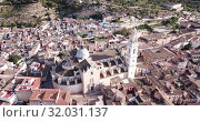 Купить «Aerial panoramic view of Xativa cityscape with Collegiate Basilica of Santa Maria, Spain», видеоролик № 32031137, снято 16 апреля 2019 г. (c) Яков Филимонов / Фотобанк Лори