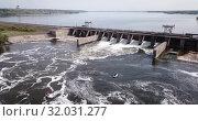Купить «Aerial view of river and pressure water dam of Voronezh city, Russia», видеоролик № 32031277, снято 4 мая 2019 г. (c) Яков Филимонов / Фотобанк Лори