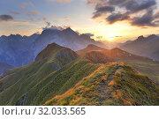 Sunset on the Marmolada Group seen from the grassy summit of Migogn Mount, Dolomites, Marmolada group, Rocca Pietore, Belluno province, Veneto, Italy. Стоковое фото, фотограф Clickalps SRLs / age Fotostock / Фотобанк Лори