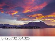 View of Isola dei Pescatori from the shore of Baveno in a winter sunrise, Piedmont, Italy. Стоковое фото, фотограф Clickalps SRLs / age Fotostock / Фотобанк Лори