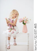 Купить «beautiful little blonde girls with flowers on white background», фото № 32037465, снято 15 августа 2019 г. (c) Майя Крученкова / Фотобанк Лори