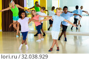 Купить «boys and girls dancing rock-and-roll in pairs with female trainer», фото № 32038929, снято 16 октября 2019 г. (c) Яков Филимонов / Фотобанк Лори