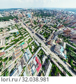 Купить «Aerial city view with crossroads and roads, houses, buildings, parks and parking lots. Sunny summer panoramic image», фото № 32038981, снято 21 января 2020 г. (c) Александр Маркин / Фотобанк Лори