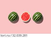 Купить «Three halves of watermelon in a row isolated on pink background.», фото № 32039281, снято 6 августа 2019 г. (c) Евдокимов Максим / Фотобанк Лори