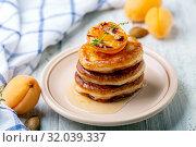 Купить «Fritters with apricot jam and thyme for breakfast», фото № 32039337, снято 13 июля 2019 г. (c) Марина Сапрунова / Фотобанк Лори