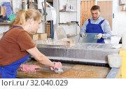 Купить «Glad man and woman working on washing machine», фото № 32040029, снято 10 сентября 2018 г. (c) Яков Филимонов / Фотобанк Лори