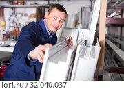 Купить «Adult workman inspecting PVC manufacturing», фото № 32040037, снято 30 марта 2017 г. (c) Яков Филимонов / Фотобанк Лори