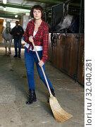 Woman sweeping floor at horse stable. Стоковое фото, фотограф Яков Филимонов / Фотобанк Лори