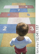 Купить «Boy learning numbers at rubber hopscotch. Numbers on the pavement. Early Education at Mathematics and Numeracy concept for children.», фото № 32041157, снято 27 июля 2019 г. (c) age Fotostock / Фотобанк Лори
