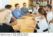 Купить «Students doing team study together in classroom», фото № 32052521, снято 5 октября 2017 г. (c) Яков Филимонов / Фотобанк Лори