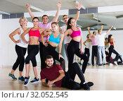Купить «Adult males and females dancing excited posing», фото № 32052545, снято 9 октября 2017 г. (c) Яков Филимонов / Фотобанк Лори