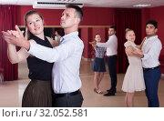 Купить «Happy dancing couples enjoying foxtrot», фото № 32052581, снято 24 мая 2017 г. (c) Яков Филимонов / Фотобанк Лори