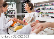 Купить «cheerful female manicurist filing and shaping nails in beauty salon», фото № 32052653, снято 28 апреля 2017 г. (c) Яков Филимонов / Фотобанк Лори