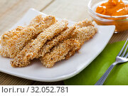 Купить «Chicken fingers in sesame with sauce», фото № 32052781, снято 8 апреля 2020 г. (c) Яков Филимонов / Фотобанк Лори