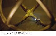 Gold Wedding Rings on a wooden floor in backlight macro closeup lensflare shoot diamon Jewellery. Стоковое видео, видеограф Aleksejs Bergmanis / Фотобанк Лори