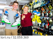 Купить «Customers are demonstrating their choice of boots», фото № 32059369, снято 31 июля 2017 г. (c) Яков Филимонов / Фотобанк Лори