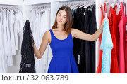 Купить «Woman shopping in clothing boutique», фото № 32063789, снято 17 сентября 2018 г. (c) Яков Филимонов / Фотобанк Лори