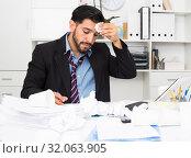 Купить «Adult businessman is sad because he is having issues at work place», фото № 32063905, снято 29 июля 2017 г. (c) Яков Филимонов / Фотобанк Лори