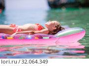 Купить «Adorable girl on inflatable air mattress in the sea», фото № 32064349, снято 19 июня 2019 г. (c) Дмитрий Травников / Фотобанк Лори