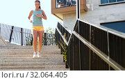 Купить «young woman running downstairs», видеоролик № 32064405, снято 4 августа 2019 г. (c) Syda Productions / Фотобанк Лори