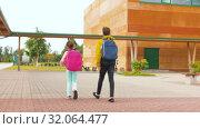 Купить «children with backpacks walking from school», видеоролик № 32064477, снято 20 августа 2019 г. (c) Syda Productions / Фотобанк Лори