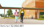 Купить «children with backpacks going to school», видеоролик № 32064481, снято 20 августа 2019 г. (c) Syda Productions / Фотобанк Лори