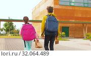 Купить «children with backpacks going to school», видеоролик № 32064489, снято 20 августа 2019 г. (c) Syda Productions / Фотобанк Лори