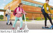 Купить «happy school children with mother riding scooters», видеоролик № 32064497, снято 20 августа 2019 г. (c) Syda Productions / Фотобанк Лори