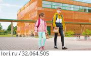 Купить «children with backpacks going to school», видеоролик № 32064505, снято 20 августа 2019 г. (c) Syda Productions / Фотобанк Лори
