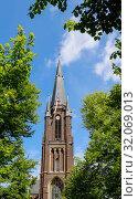 Купить «Sacrificial candles burning in front of the candle chapel, Kevelaer, North Rhine-Westphalia, Germany», фото № 32069013, снято 5 мая 2019 г. (c) Caro Photoagency / Фотобанк Лори