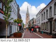 Купить «Shopping street with Marienbasilika, Kevelaer, North Rhine-Westphalia, Germany», фото № 32069021, снято 5 мая 2019 г. (c) Caro Photoagency / Фотобанк Лори